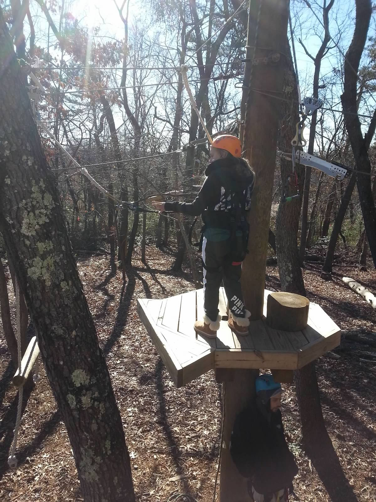Student participates in ropes course