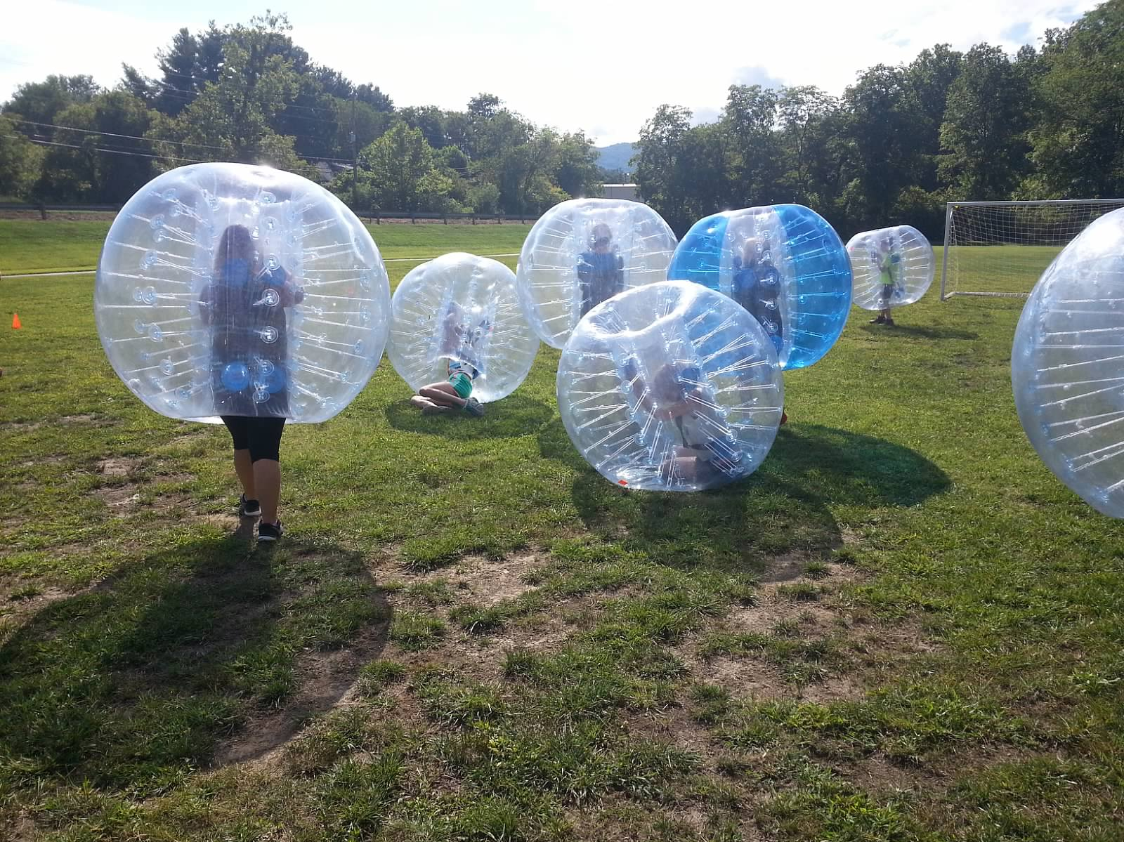 Students playing bubble soccer